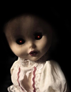 Vintage spooky doll